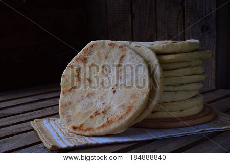 Pile Of Homemade Flat Bread On A Wooden Background. Mexican Flatbread Taco. Indian Naan. Space For T