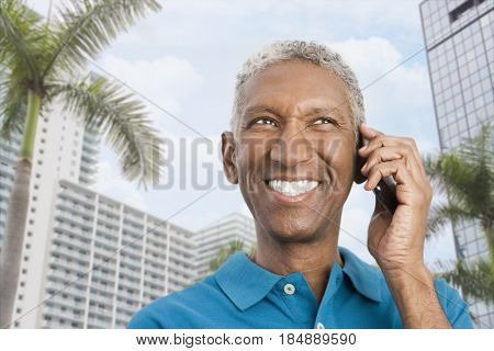 Smiling mixed race man talking on cell phone