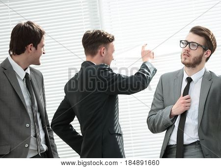 CFO and business team discuss the company's profit in the office