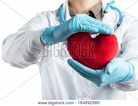 Female cardiologist in uniform holding red heart isolated on the white background