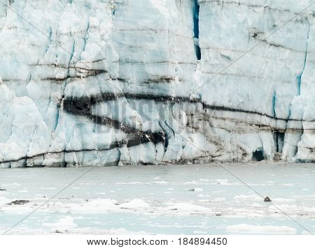Glacier face with foliation pattern and black streaks