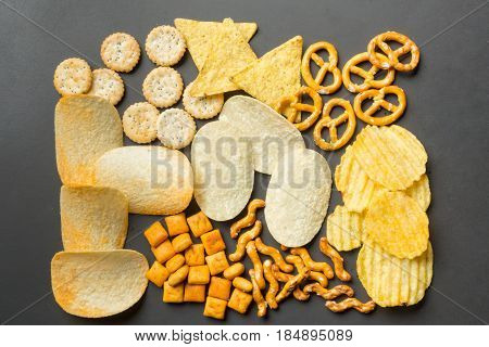 Salty snacks. Pretzels chips crackers . top view