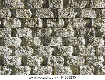 Seamless rough old stone wall background texture