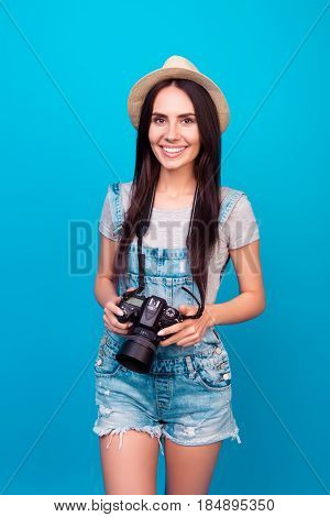 Vertical Portrait Of Cute Smiling Female Professional Photographer Holding Digital Camera And Standi