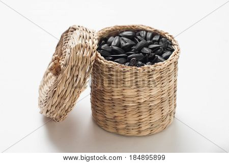 Sunflower Seeds In A Wicker Basket With Lid On White Background,