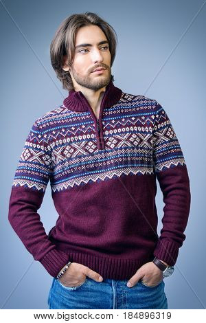 Handsome man wearing winter pullover. Men's beauty, fashion. Hairstyle for men. Studio shot.