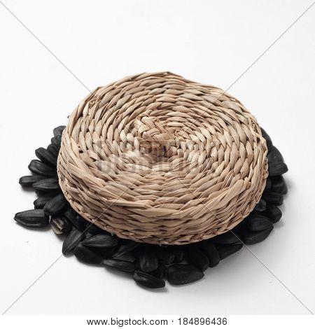 Dry Sunflower Seeds Under Straw Braided Cap,