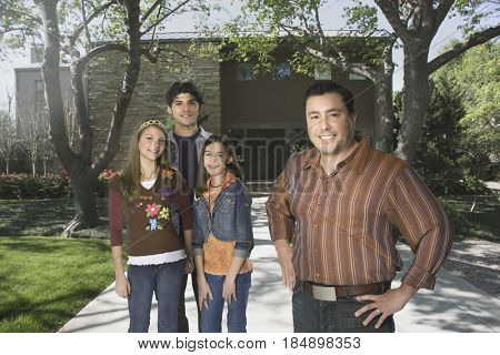 Father and children standing in driveway