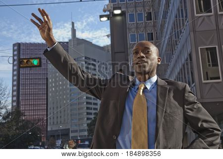 African American businessman hailing a taxi