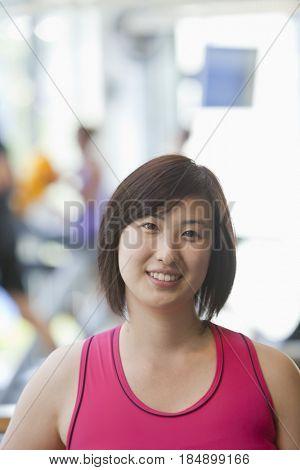 Smiling Korean woman in health club