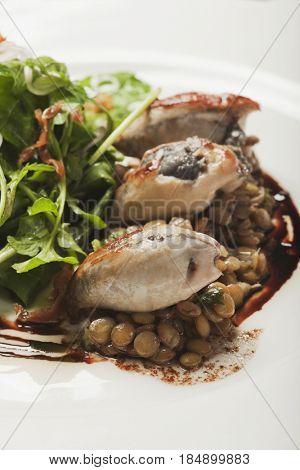 Salad and seafood entree on plate