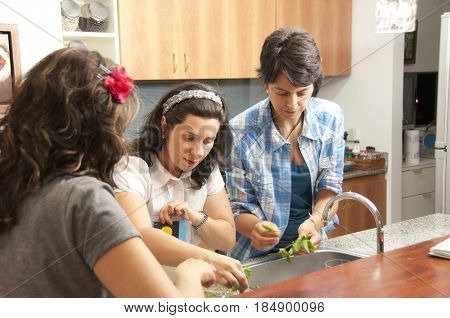Hispanic women preparing food together