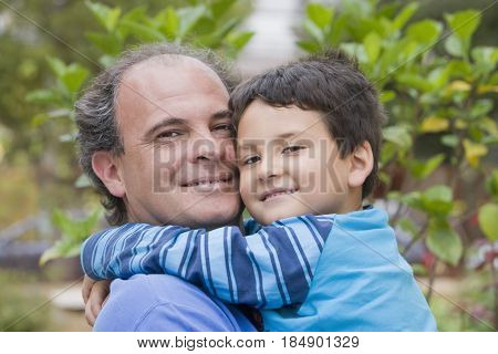 Chilean father and son hugging