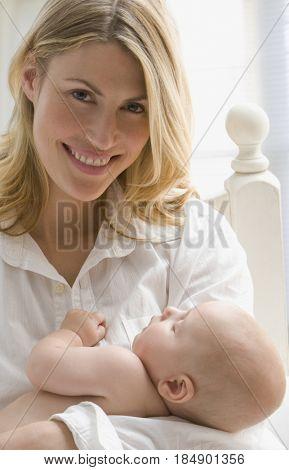 Caucasian mother cradling baby boy