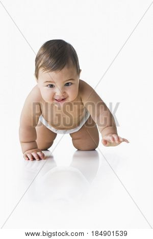 Mixed race baby boy crawling on floor
