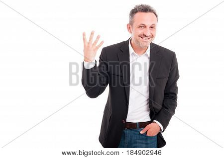 Cheerful Businessman Showing Four Fingers
