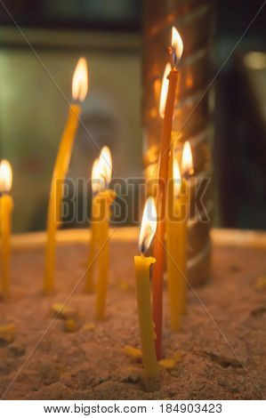 The Lit Candles In Church Against
