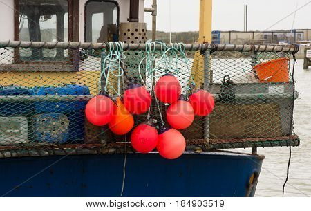 Floatation buoys and netting on back of fishing boat in Littlehampton Harbour West Sussex England