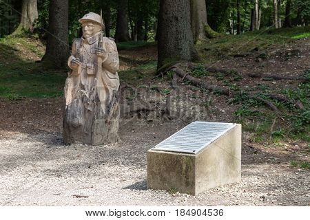 VERDUN FRANCE - AUGUST 19 2016: Memorial tablet and woodcarving soldier in Fleury French village completely destroyed in First World War One