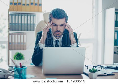 Young Serious Businessman In Formal Wear With Tie Touching His Temples And Trying To Concentrate Whi