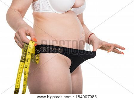 Young Plus Size Woman In Underwear With Measure Tape