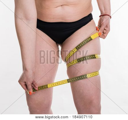 Plus Size Woman Model Measuring Her Leg With Measure Tape