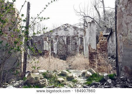 Ruins of the destroyed building or premises.