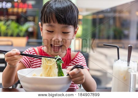 Asian Little Chinese Girl Eating Noodles Soup