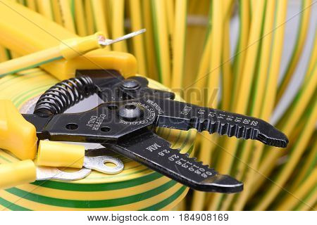 Tool and yellow  cable for electrical installation