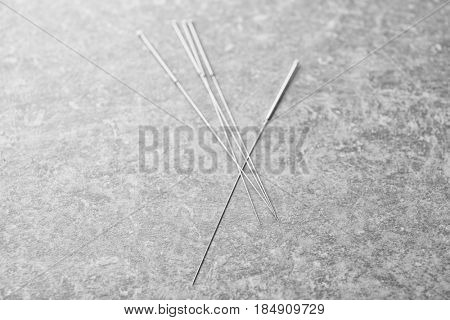 Needles for acupuncture on grey background