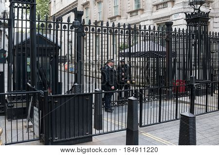 LONDON UK - APRIL 25 2017: Police guard on front of the gate of British Prime Minister residence on Downing Street 10