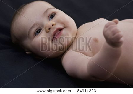 Grinning mixed race baby boy