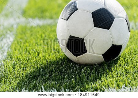 close up view of soccer ball on grass in corner kick position on soccer field stadium