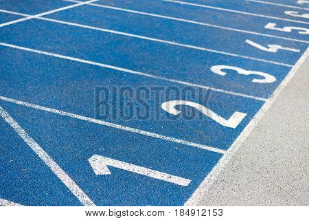 close up view of numeration of running track on stadium