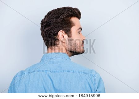 Back View Of Stylish Young Brunet Man With Modern Hairstyle On Light Blue Background