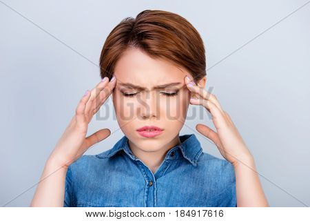 Cute Young Girl Is Suffering From Strong Headache. She Is Holding Her Head With Hands