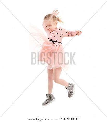 Funny girl jumping high, expressing herself, pinkish skirt jumps up, laughing and enjoying time, isolated
