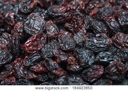 raisins background. Dark dried grapes background.  Dried fruit