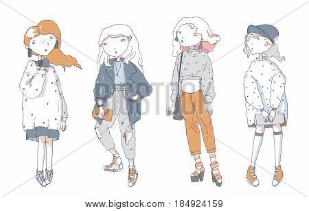 Hipster cute girls in casual oversized clothes hand drawn isolated on white background. Vector set with color fashion women in different poses. Pastel colors. Concept for young lovely character