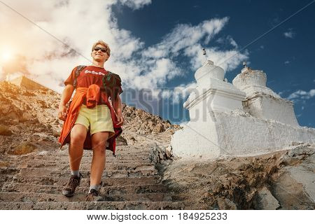 Young tourist man visit the tibetian holy places in Himalaya mountain