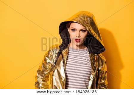 Bright Studio Photo Of Attractive Young Girl With Red Lips, Beautiful Face And In Golden Outerwear I