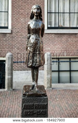 Amsterdam, Netherlands - April, 2017: Statue of Anne Frank in Amsterdam, Netherlands. The statue by Dutch sculptor Mari Andriessen near Westerkerk church.