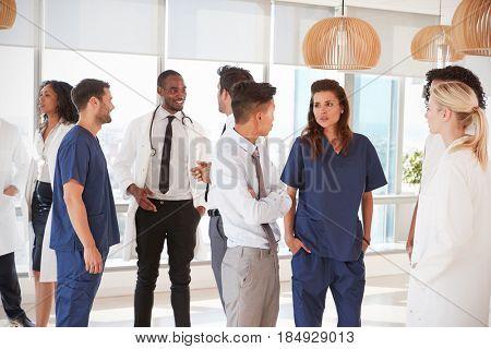 Medical Staff Having Informal Meeting In Hospital