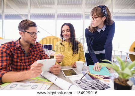 Business people discussing at desk during meeting in office
