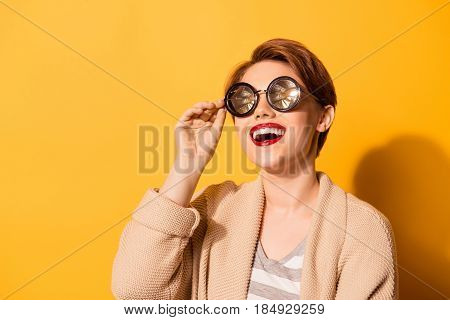 Wow! Beaming Smile Of A Fashion Model In Spectacular Sunglasses On Bright Beige Background