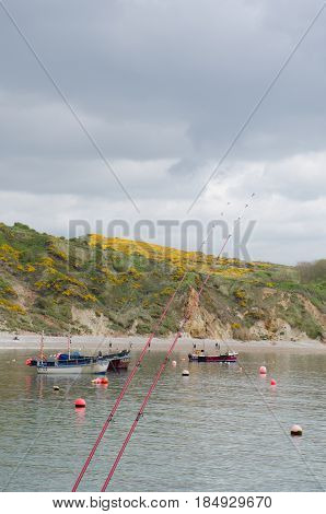 Lulworth Cove Dorset United Kingdom -22 April 2017: Fishing rods at Lulworth Cove Dorset