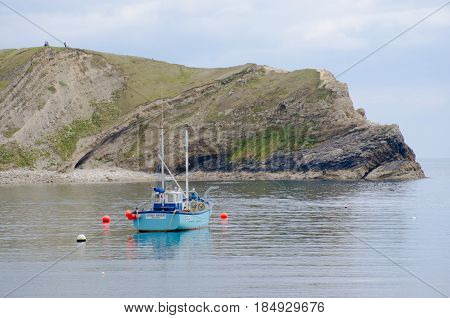 Lulworth Cove Dorset United Kingdom -22 April 2017: Fishing boat at Lulworth Cove Dorset