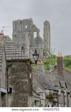 Corfe Castle Dorset United Kingdom -23 April 2017: Corfe village with castle in background