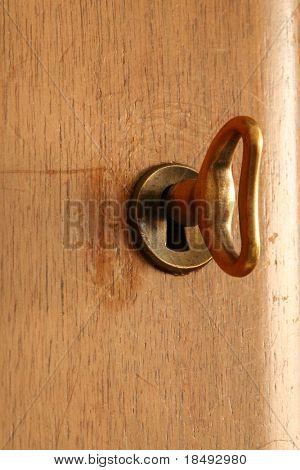 Closeup of a key in a lock.
