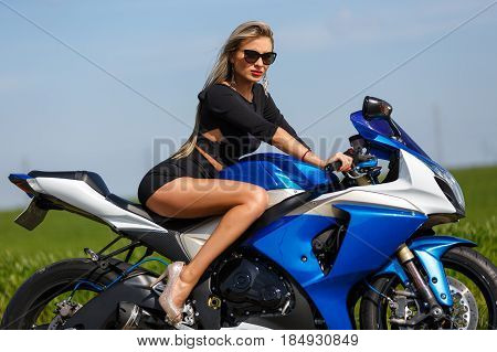 Portrait Of A Beautiful Woman And A Motorcycle Of Speed